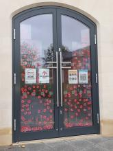 Remembrance Sunday: Covering glass door with poppies